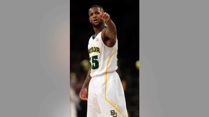 Baylor's Pierre Jackson (55) points to the crowd during the second half of an NIT semifinal basketball game against Brigham Young Tuesday, April 2, 2013, in New York. (AP Photo/Frank Franklin)