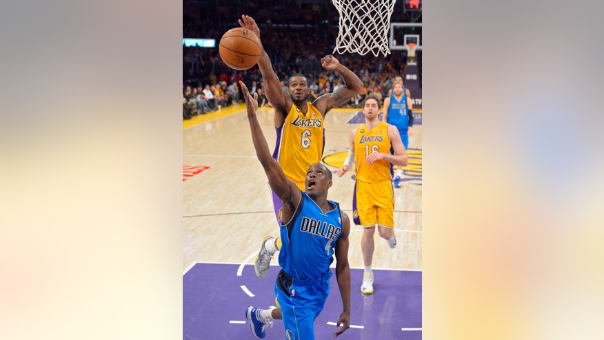 Dallas Mavericks guard Darren Collison, below, puts up a shot as Los Angeles Lakers forward Earl Clark defends and forward Pau Gasol, of Spain, watche during the first half of an NBA basketball game, Tuesday, April 2, 2013, in Los Angeles. (AP Photo/Mark J. Terrill)