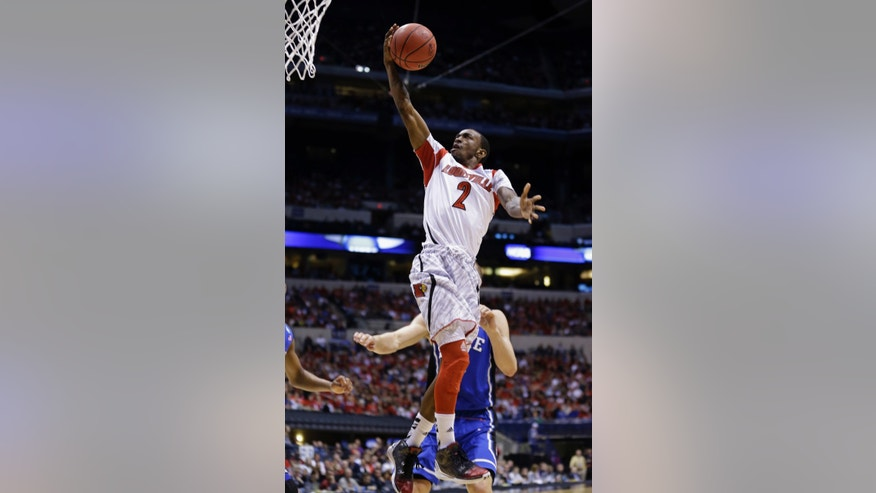 Louisville guard Russ Smith (2) goes up with a layup against Duke defense during the first half of the Midwest Regional final in the NCAA college basketball tournament, Sunday, March 31, 2013, in Indianapolis. Louisville won 85-63 to advance to the Final Four. (AP Photo/Michael Conroy)