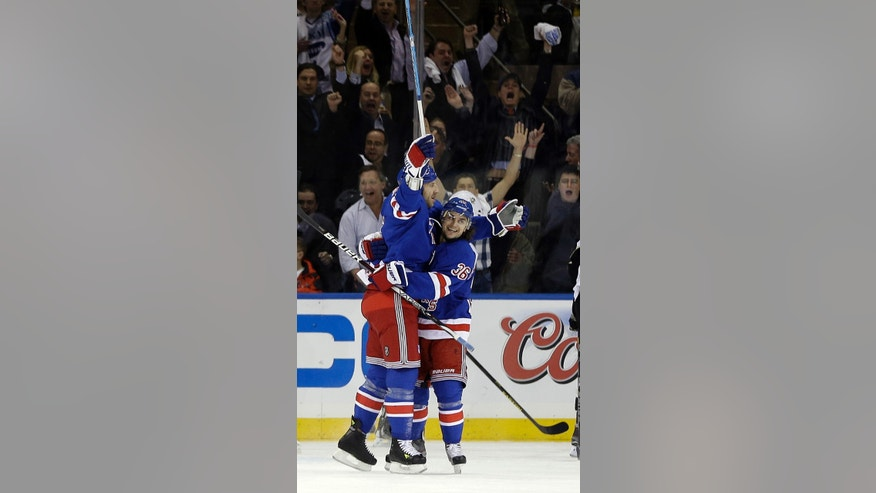 New York Rangers' Ryane Clowe, left, celebrates with teammate Mats Zuccarello (36) after scoring a goal during the first period of an NHL hockey game against the Pittsburgh Penguins, Wednesday, April 3, 2013, in New York. (AP Photo/Frank Franklin II)