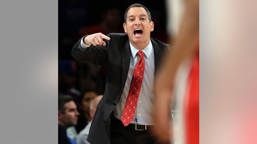 FILE - In this March 12, 2013, file photo, Rutgers coach Mike Rice yells out to his team during an NCAA college basketball game against DePaul at the Big East tournament in New York. Rutgers said it would reconsider its decision to retain Rice after a videotape aired showing him shoving, grabbing and throwing balls at players in practice and using gay slurs. The videotape, broadcast Tuesday, April 2, on ESPN, prompted scores of outraged social media comments as well as sharp criticism from Gov. Chris Christie and NBA star LeBron James. (AP Photo/Frank Franklin II, File)