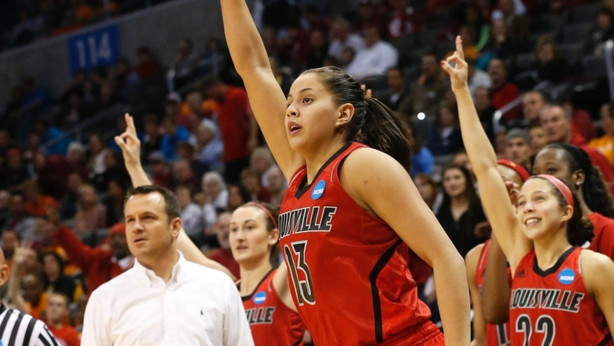 Louisville guard Shoni Schimmel (23) and the Louisville bench react to her 3-point shot against Tennessee in the second half of the regional final in the NCAA women's college basketball tournament in Oklahoma City, Tuesday, April 2, 2013. Louisville won 86-78. (AP Photo/Sue Ogrocki)