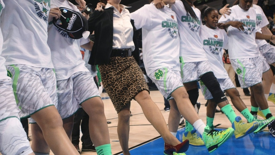 Notre Dame coach Muffet McGraw, center, dances with her players as they celebrate an 87-76 win over Duke in the regional final of the NCAA women's college basketball tournament Tuesday, April 2, 2013, in Norfolk, Va. (AP Photo/Jason Hirschfeld)