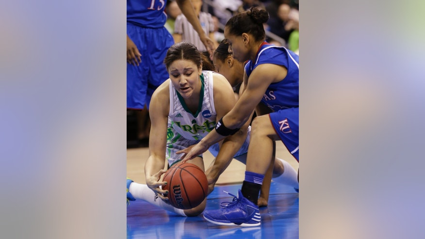 Notre Dame forward Natalie Achonwa ,left, tries to claim a rebound as Kansas guard Angel Goodrich (3) reaches in during the first half of a regional semi-final of the NCAA college basketball tournament  Sunday March 31, 2013, in Norfolk, Va.  (AP Photo/Steve Helber)