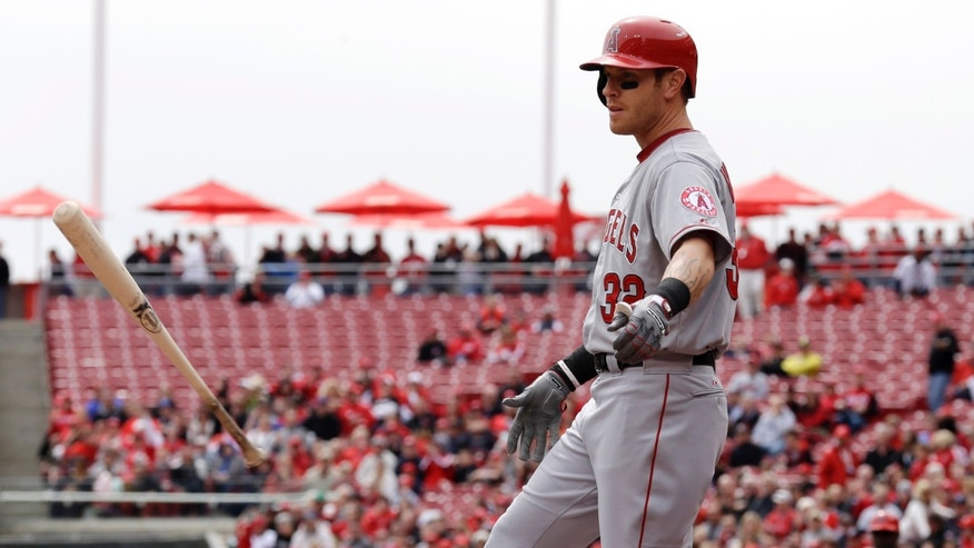 Los Angeles Angels' Josh Hamilton flips his bat after striking out against the Cincinnati Reds in the first inning of an interleague baseball game, Thursday, April 4, 2013, in Cincinnati. (AP Photo/Al Behrman)