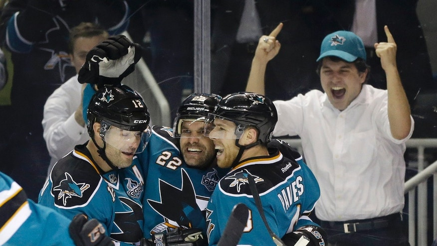 San Jose Sharks' Dan Boyle, center, celebrates his goal with teammates Joe Pavelski, right, and Patrick Marleau during the first period of an NHL hockey game against the Minnesota Wild in San Jose, Calif., Wednesday, April 3, 2013. (AP Photo/Marcio Jose Sanchez)