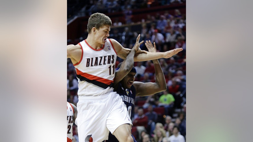 Portland Trail Blazers center Meyers Leonard, left, hits Memphis Grizzlies forward Zach Randolph in the head as he fouls him on a rebound during the first quarter of an NBA basketball game in Portland, Ore., Wednesday, April 3, 2013.(AP Photo/Don Ryan)