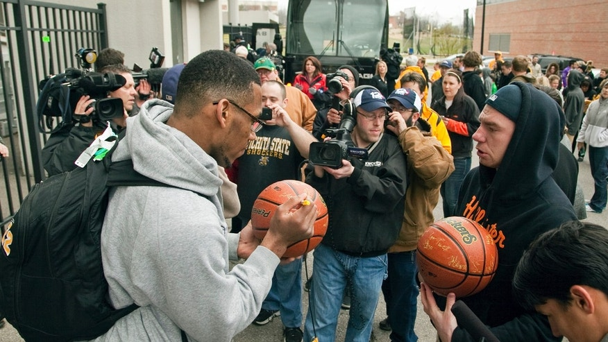 Wichita State's Carl Hall signs autographsr fans outside Koch Arena in Wichita, Kan., Wednesday, April 3, 2013, as the team gets ready to board a bus to the airport. The Shockers are heading to Atlanta to play in the NCAA college basketball tournament's Final Four. (AP Photo/The Wichita Eagle, Mike Hutmacher) LOCAL TV OUT; MAGS OUT; LOCAL RADIO OUT; LOCAL INTERNET OUT