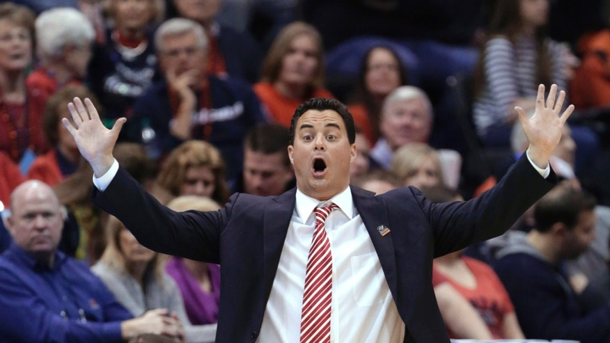 FILE - In this March 23, 2013, file photo, Arizona coach Sean Miller shouts to his team in the first half against Harvard in the NCAA men's college basketball tournament in Salt Lake City. Ed Rush resigned as the Pac-12 Conference's coordinator of officials on Thursday, April 4, 2013, following comments during internal meetings before the league tournament that appeared to target Miller, including perceived accusations that he placed a bounty on the Wildcats coach. (AP Photo/Rick Bowmer, File)