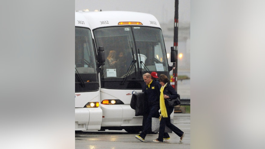 Michigan head coach John Beilein arrives with the team, Wednesday, April 3, 2013, for their NCAA Final Four college basketball tournament game against Syracuse on Saturday in Atlanta. (AP Photo/David Tulis)