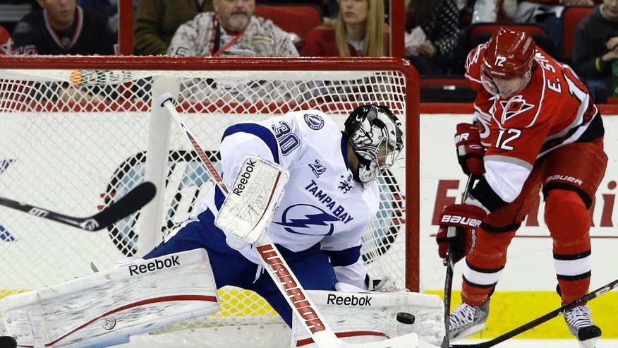 Carolina Hurricanes' Eric Staal (12) tries to score against Tampa Bay Lightning goalie Ben Bishop (30) during the first period of an NHL hockey game in Raleigh, N.C., Thursday, April 4, 2013. (AP Photo/Gerry Broome)
