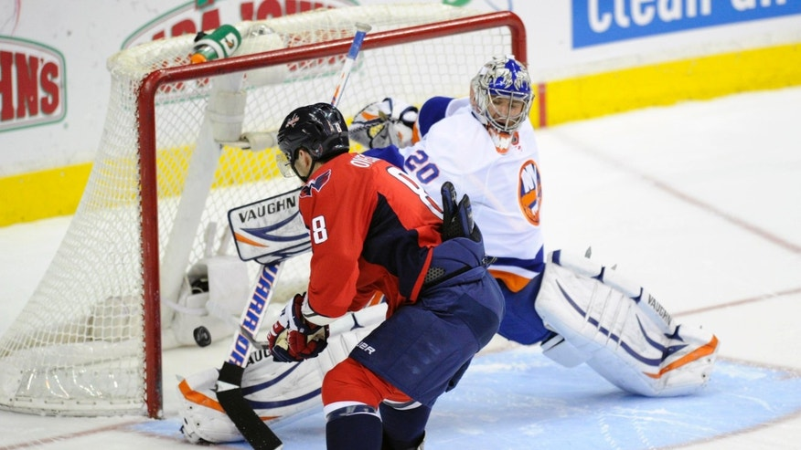 Washington Capitals left wing Alex Ovechkin (8), of Russia, scores a goal against New York Islanders goalie Evgeni Nabokov (20), of Kazakhstan, during a shootout in an NHL hockey game, Thursday, April 4, 2013, in Washington. The Capitals won 2-1 after overtime and the shootout. (AP Photo/Nick Wass)