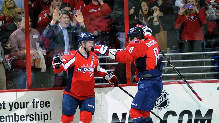 Washington Capitals defenseman Mike Green, left, celebrates his goal with teammate Alex Ovechkin (8), of Russia, against the New York Islanders during the first period of an NHL hockey game on Thursday, April 4, 2013, in Washington. (AP Photo/Nick Wass)