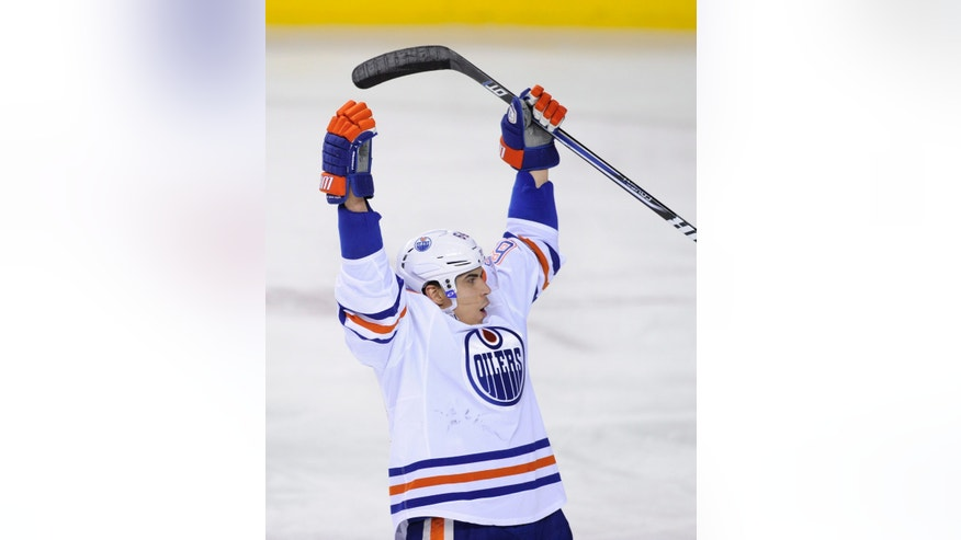 Edmonton Oilers' Nail Yakupov celebrates his goal against the Calgary Flames during second period NHL action in Calgary, Alberta Wednesday April 3, 2013. (AP Photo/The Canadian Press, Larry MacDougal)