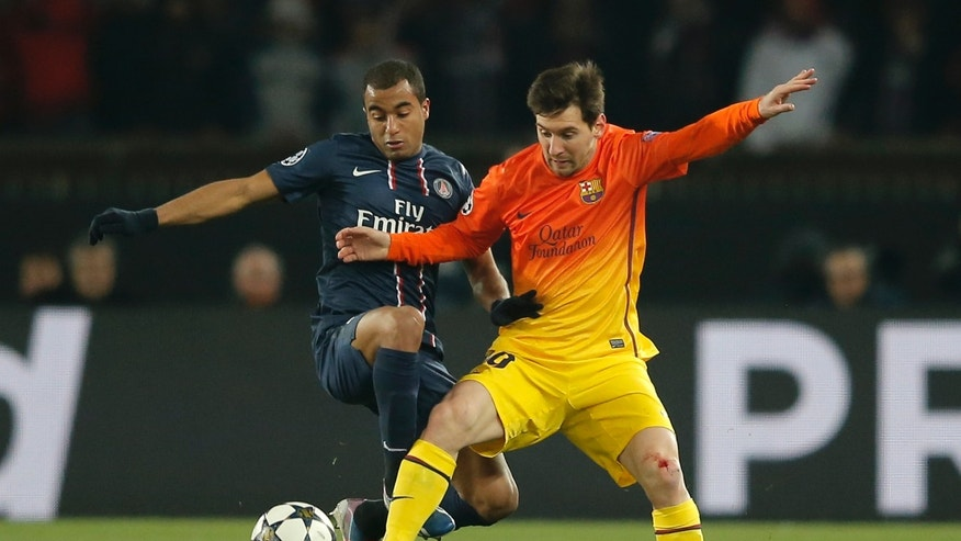 Barcelona's Llionel Messi, right, vies for the ball with Paris Saint Germain's Thiago Silva during their UEFA Champions League quarterfinal first leg match between PSG and Barcelona at Parc des Princes stadium, in Paris, Tuesday April 2, 2013. (AP Photo/Francois Mori)