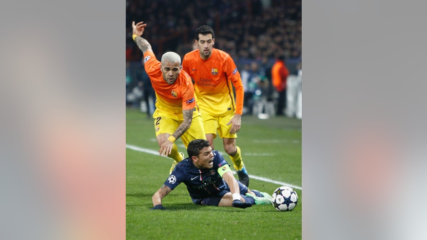 Barcelona's Daniel Alves, left, vies for the ball with Paris Saint Germain's Thiago Silva, of Brazil, during their UEFA Champions League quarterfinal first leg match between PSG and Barcelona at Parc des Princes stadium, in Paris, Tuesday April 2, 2013. (AP Photo/Francois Mori)