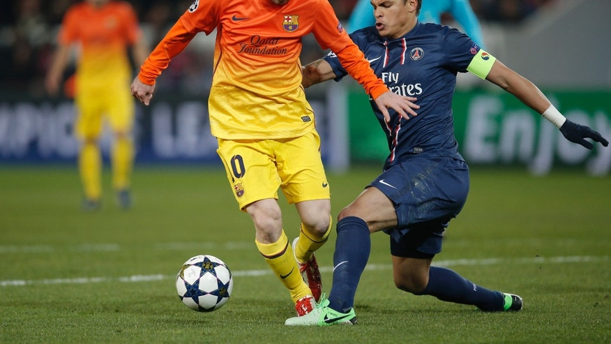 Barcelona's Lionel Messi, left, battles for the ball with Paris Saint Germain's Thiago Silva during their Champions League quarterfinal soccer match in Paris,Tuesday, April 2, 2013. (AP Photo/Christophe Ena)