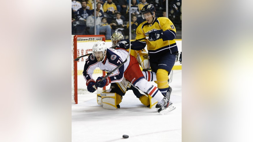 Columbus Blue Jackets forward Nick Foligno (71) falls as Nashville Predators goalie Pekka Rinne, of Finland, and defenseman Kevin Klein (8) keep him away from the net in the first period of an NHL hockey game on Thursday, April 4, 2013, in Nashville, Tenn. Rinne was called for tripping on the play. (AP Photo/Mark Humphrey)
