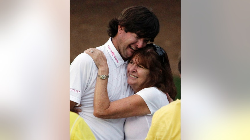 ADVANCE FOR WEEKEND EDITIONS, APRIL 6-7 - FILE - In this April 8, 2012, file photo, Bubba Watson hugs his mother Molly after winning the Masters golf tournament following a sudden death playoff on the 10th hole in Augusta, Ga. Watson held his right arm out to his side as his tee shot sailed toward the woods to the right of the 10th fairway at Augusta, and it looked as though he would be only the latest victim on what is perenially the toughest hole at the Masters. What followed was a great escape and a green jacket. (AP Photo/Matt Slocum, File)