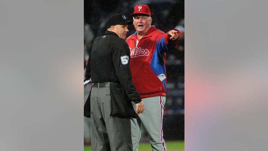 Philadelphia Phillies manager Charlie Manuel, right, argues a call with umpire Mike Everitt, left, during the seventh inning against the Atlanta Braves in a baseball game, Wednesday, April 3, 2013, in Atlanta. (AP Photo/John Amis)