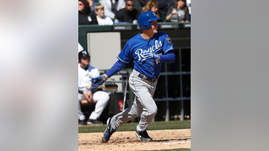 Kansas City Royals' Chris Getz watches his RBI-single off Chicago White Sox starting pitcher Gavin Floyd, scoring Jeff Francoeur, during the fifth inning of a baseball game on Thursday, April 4, 2013, in Chicago. (AP Photo/Charles Rex Arbogast)