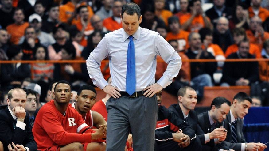 FILE - In this Jan. 2, 2013 file photo, Rutgers head coach Mike Rice reacts after Syracuse scored late in the second half of an NCAA college basketball game in Syracuse, N.Y. Rutgers has fired Rice after a videotape aired showing him shoving, grabbing and throwing balls at players in practice and using gay slurs during practice. With mounting criticism on a state and national level, the school decided to take action on Wednesday, April 3, 2013. relieving Rice of his duties after three largely unsuccessful seasons at the Big East school. (AP Photo/Kevin Rivoli, File)