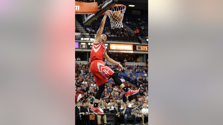 Houston Rockets guard Jeremy Lin dunks against the Sacramento Kings during the first quarter of an NBA basketball game in Sacramento, Calif., Wednesday, April 3, 2013. (AP Photo/Rich Pedroncelli)