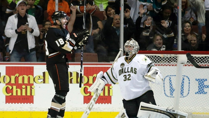 Anaheim Ducks' Radek Dvorak, left, of the Czech Republic, celebrates his goal against Dallas Stars goalie Kari Lehtonen (32) during the first period of an NHL hockey game in Anaheim, Calif., Wednesday, April 3, 2013. (AP Photo/Jae C. Hong)