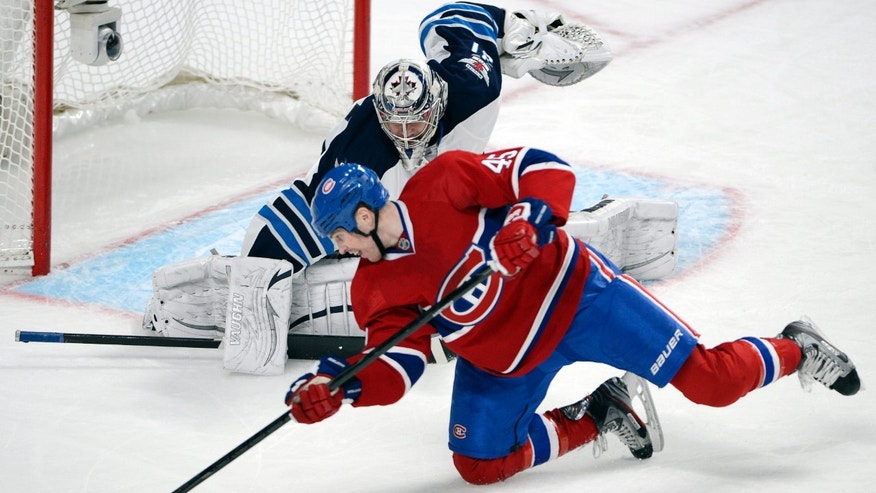 Montreal Canadiens right wing Michael Blunden (45) is stopped by Winnipeg Jets goalie Ondrej Pavelec during the third period of an NHL hockey game Thursday, April 4, 2013, in Montreal. (AP Photo/The Canadian Press, Ryan Remiorz)