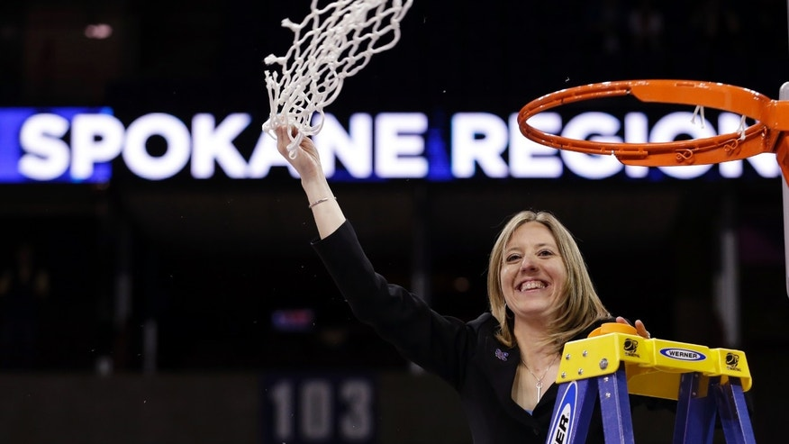 California head coach Lindsay Gottlieb waves the net overhead after finishing cutting it down after her team beat Georgia in overtime in a regional final in the NCAA women's college basketball tournament, Monday, April 1, 2013, in Spokane, Wash. Cal won 65-62. (AP Photo/Elaine Thompson)