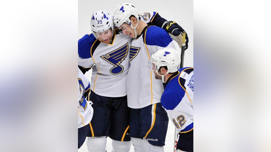 St. Louis Blues' Adam Cracknell, right, celebrates with teammate Jordan Leopold, left, after scoring against the Chicago Blackhawks during the first period of an NHL hockey game in Chicago, Thursday April, 4, 2013. (AP Photo/Paul Beaty)