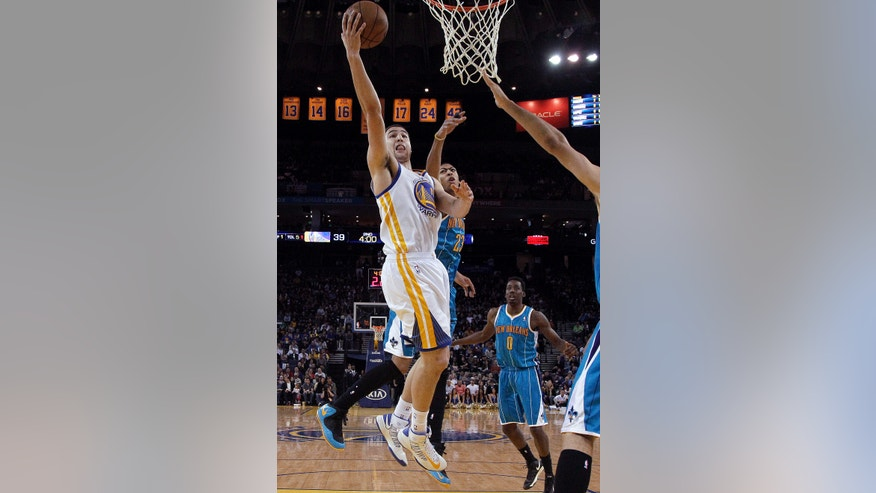 Golden State Warriors guard Klay Thompson (11) shoots against New Orleans Hornets forward Anthony Davis (23) during the second quarter of an NBA basketball game in Oakland, Calif., Wednesday, April 3, 2013. (AP Photo/Jeff Chiu)