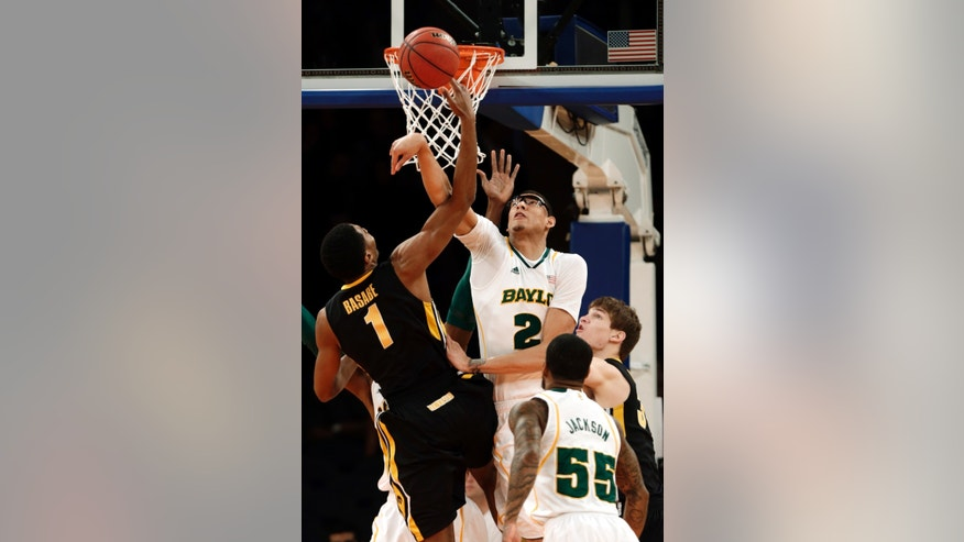 Baylor's Rico Gathers (2) blocks a shot by Iowa's Melsahn Basabe (1) during the first half of the NIT championship basketball game Thursday, April 4, 2013, in New York. (AP Photo/Frank Franklin II)