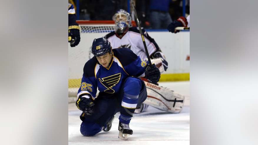 St. Louis Blues' Chris Stewart, foreground, celebrates after scoring past Columbus Blue Jackets goalie Sergei Bobrovsky, background, of Russia, during the second period of an NHL hockey game on Friday, April 5, 2013, in St. Louis. (AP Photo/Jeff Roberson)