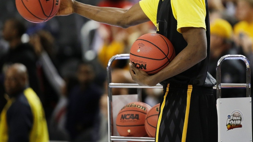 Wichita State's Cleanthony Early hands out balls during practice for their NCAA Final Four tournament college basketball semifinal game against Louisville, Friday, April 5, 2013, in Atlanta. Wichita State plays Louisville in a semifinal game on Saturday. (AP Photo/David J. Phillip)