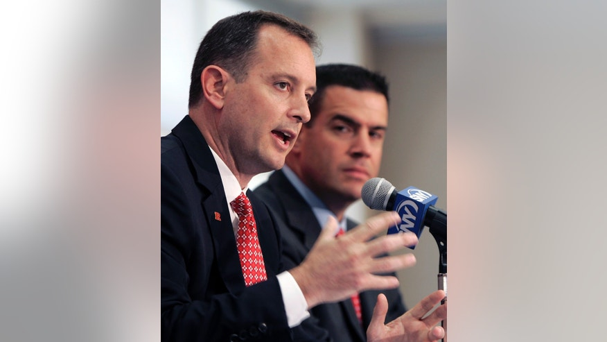 In this May 6, 2010 file photo Mike Rice, left, is introduced as men's basketball coach at Rutgers during a news conference as Tim Pernetti, the school's athletic director, listens in Piscataway, N.J.  Some Rutgers alumni say Pernetti should be dismissed over his handling of Rice's behavior and some are questioning what university President Robert Barchi knew, and when.(AP Photo/Rich Schultz)
