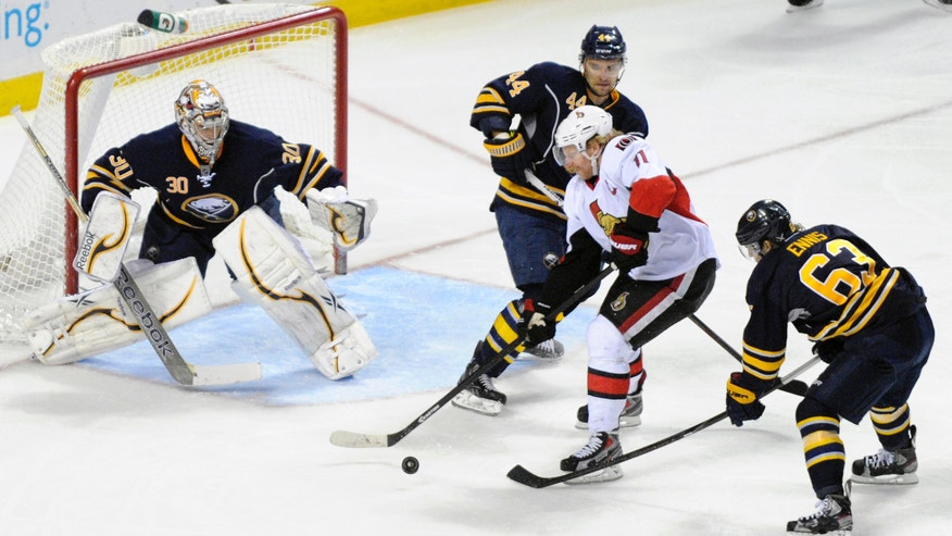 Buffalo Sabres goaltender Ryan Miller (30), defenseman Andrej Sekera (44), and center Tyler Ennis (63) defend against Ottawa Senators right winger Daniel Alfredsson during the third period of an NHL hockey game in Buffalo, N.Y., Friday, April 5, 2013. (AP Photo/Gary Wiepert)