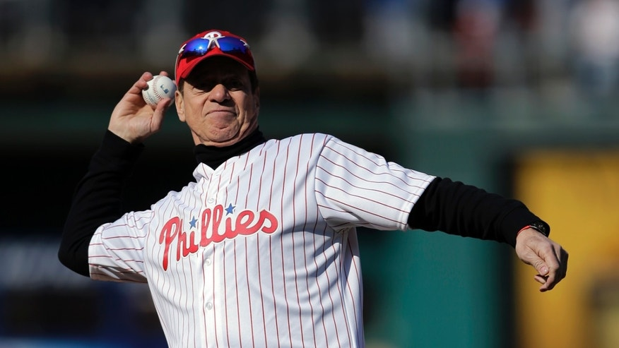 Comedian and actor Joe Piscopo throws out a ceremonial first pitch before an opening day baseball game between the Philadelphia Phillies and the Kansas City Royals, Friday, April 5, 2013, in Philadelphia. (AP Photo/Matt Slocum)