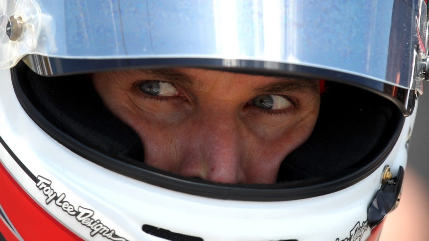 Will Power, of Australia, gets ready to take a few laps during practice for the IndyCar Grand Prix of Alabama auto race in Birmingham, Ala. on Friday, April 5, 2013. (AP Photo/Butch Dill)