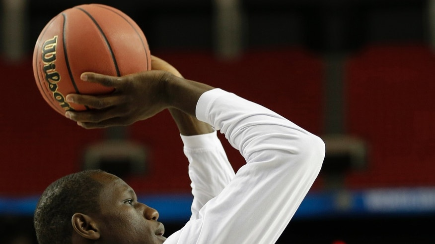 Louisville's Gorgui Dieng shoots during practice for their NCAA Final Four tournament college basketball semifinal game against Wichita State, Friday, April 5, 2013, in Atlanta. Louisville plays Wichita State in a semifinal game on Saturday. (AP Photo/David J. Phillip)