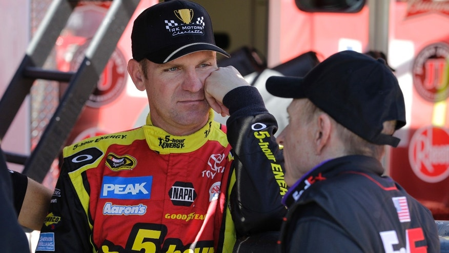 Driver Clint Bowyer, left, talks with Mark Martin, right, after practice for Sunday's NASCAR Sprint Cup series auto race at Martinsville Speedway in Martinsville, Va., Friday, April 5, 2013. (AP Photo/Steve Helber)