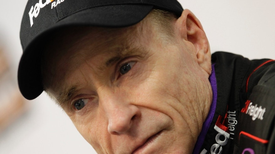 Driver Mark Martin listens to a question during a press conference at Martinsville Speedway in Martinsville, Va.  Friday April 5, 2013. Martin will drive for the injured Denny Hamlin in Sunday's NASCAR Sprint Cup series race.   (AP Photo/Steve Helber)