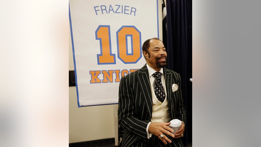 "New York Knicks Hall-of-Famer Walt ""Clyde"" Frazier responds to questions during an interview before an NBA basketball game between the Knicks and the Milwaukee Bucks, Friday, April 5, 2013, in New York. The Knicks will honor the 1972-73 world championship team in a halftime ceremony. (AP Photo/Frank Franklin II)"