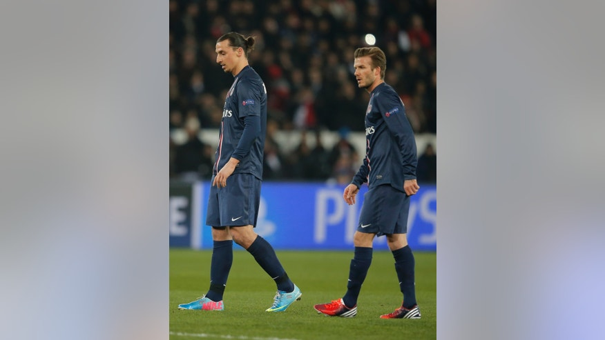 Paris Saint Germain's David Beckham, right, and Zlatan Ibrahimovic react during their UEFA Champions League quarterfinal first leg match between PSG and Barcelona at Parc des Princes stadium, in Paris, Tuesday April 2, 2013. (AP Photo/Francois Mori)