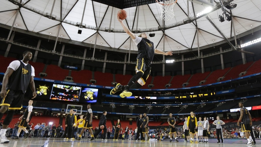 Wichita State's Ron Baker heads to the hoop during practice at the Final Four of the NCAA college basketball tournament, Friday, April 5, 2013, in Atlanta. Wichita State plays Louisville in a national semifinal on Saturday. (AP Photo/David J. Phillip)