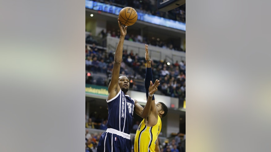 Oklahoma City Thunder's Kevin Durant, left, shoots over Indiana Pacers' Paul George during the first half of an NBA basketball game on Friday, April 5, 2013, in Indianapolis. (AP Photo/Darron Cummings)