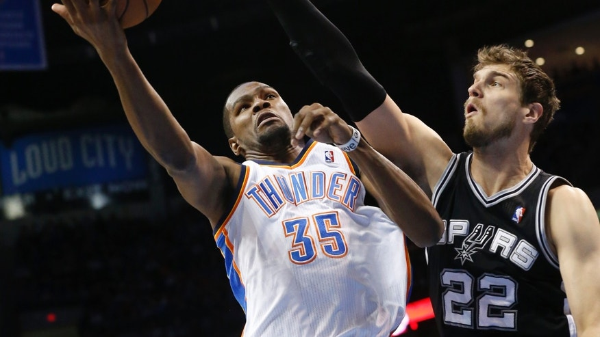 Oklahoma City Thunder forward Kevin Durant (35) shoots in front of San Antonio Spurs center Tiago Splitter (22) in the first quarter of an NBA basketball game in Oklahoma City, Thursday, April 4, 2013. (AP Photo/Sue Ogrocki)
