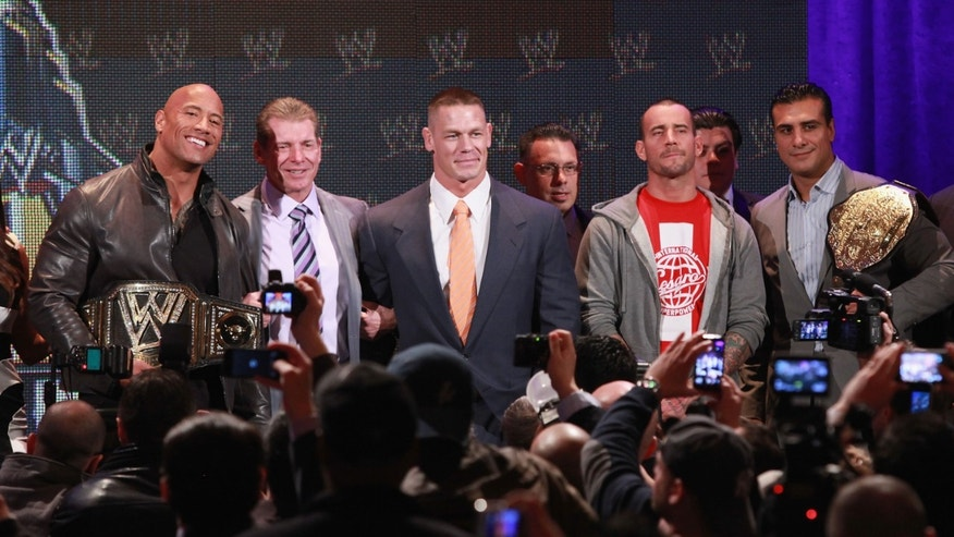 NEW YORK, NY - APRIL 04:  The Rock, Vince McMahon, John Cena, CM Punk attend the WrestleMania 29 Press Conference at Radio City Music Hall on April 4, 2013 in New York City.  (Photo by Taylor Hill/Getty Images)