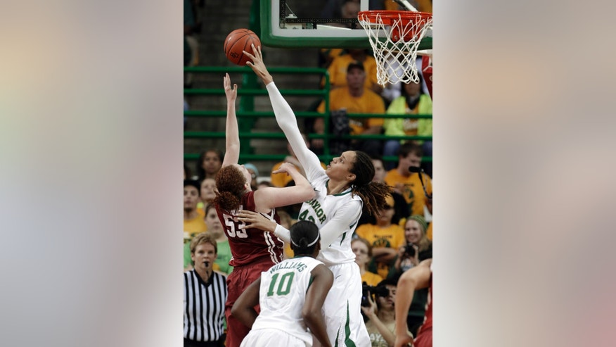 FILE - In this Jan. 26, 2013 file photo, Baylor's Brittney Griner (42) blocks the shot of Oklahoma's Joanna McFarland (53) during the second half of an NCAA college basketball game in Waco Texas. Griner was selected to the 2012-13 AP Women's All-America team, Tuesday, April 2, 2013.  (AP Photo/LM Otero, FIle)