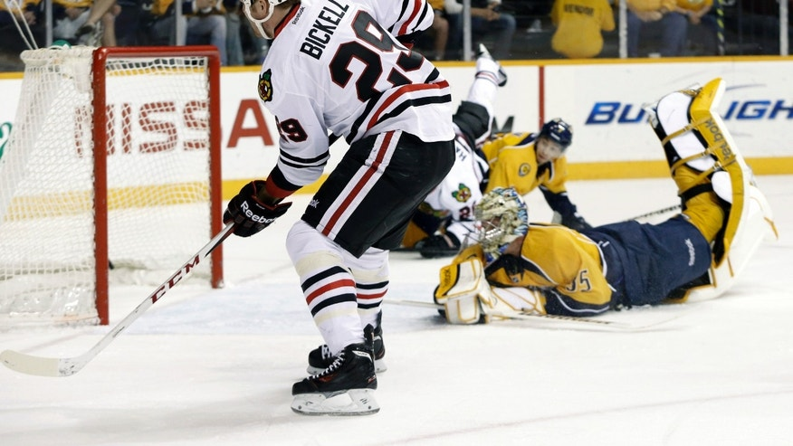 Chicago Blackhawks left wing Bryan Bickell (29) scores against Nashville Predators goalie Pekka Rinne (35), of Finland, in the first period of an NHL hockey game on Saturday, April 6, 2013, in Nashville, Tenn. (AP Photo/Mark Humphrey)